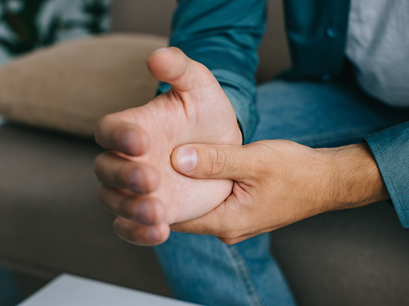 close-up partial view of man having wrist pain
